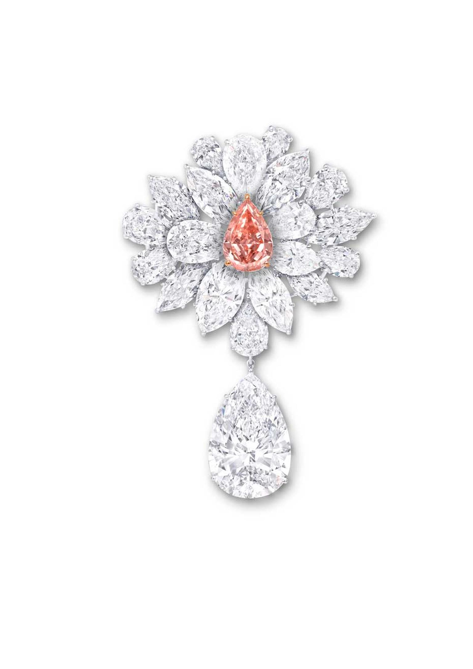 Graff's Diamond Flower Brooch features an 8.97ct pear-shaped Fancy Vivid Pink Orange diamond, surrounded by a spray of white diamond petals and leaves. The brooch is further enhanced with a 38.13ct D Flawless pear-shaped white diamond suspended from a lea