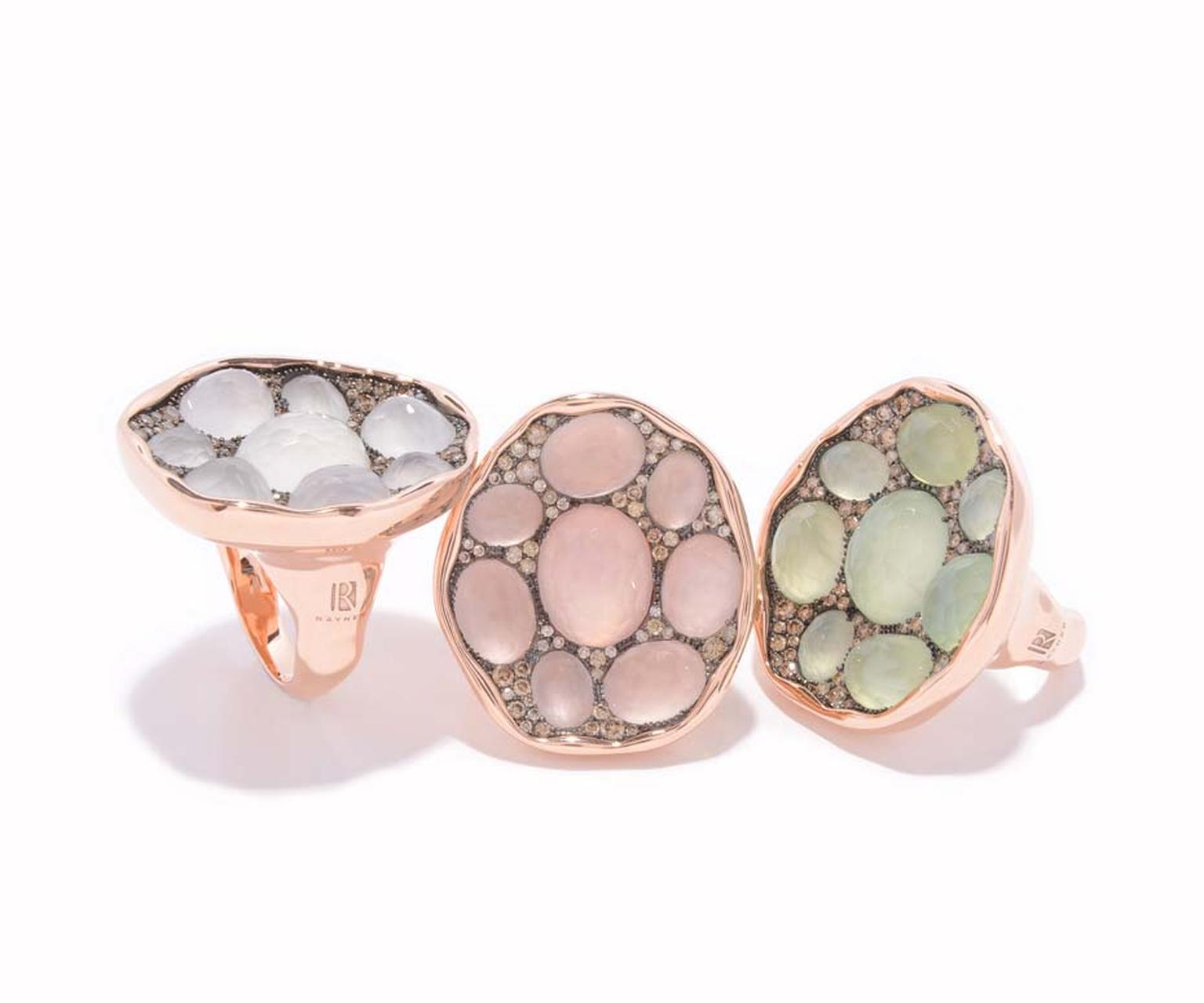 Rodney Rayner red gold rings featuring, from left to right, 8 white quartz, 8 rose quartz and 8 prehnites surrounded by a sprinkling of diamonds.