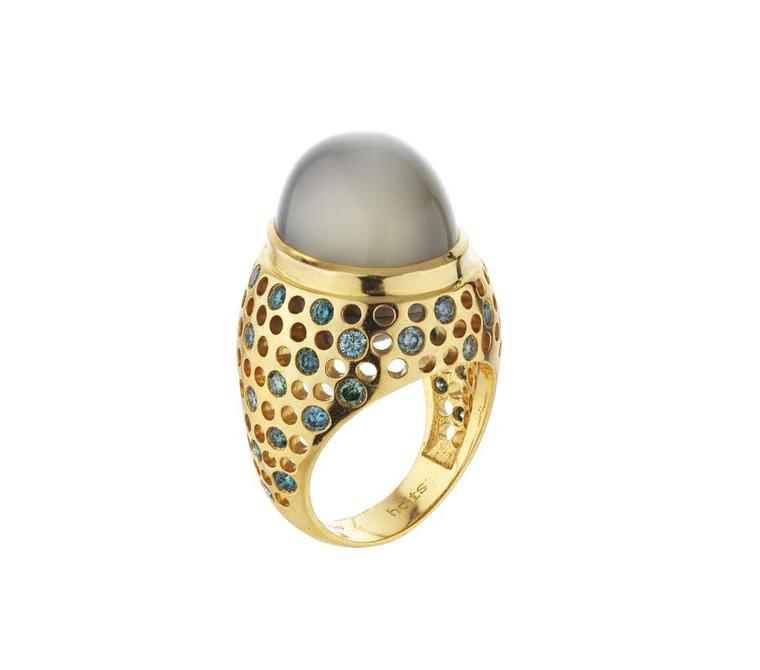 Holts Vicious moonstone ring featuring a yellow gold band studded with blue and green diamonds.