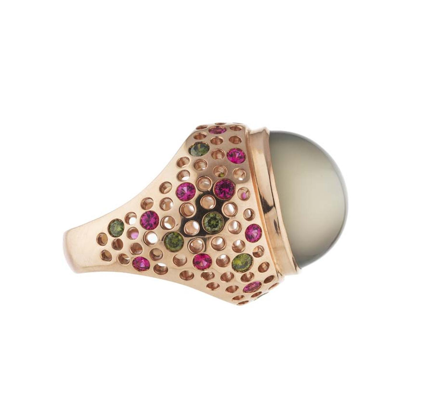 Holts Vivienne moonstone ring featuring a rose gold band studded with natural pink spinels and green diamonds.