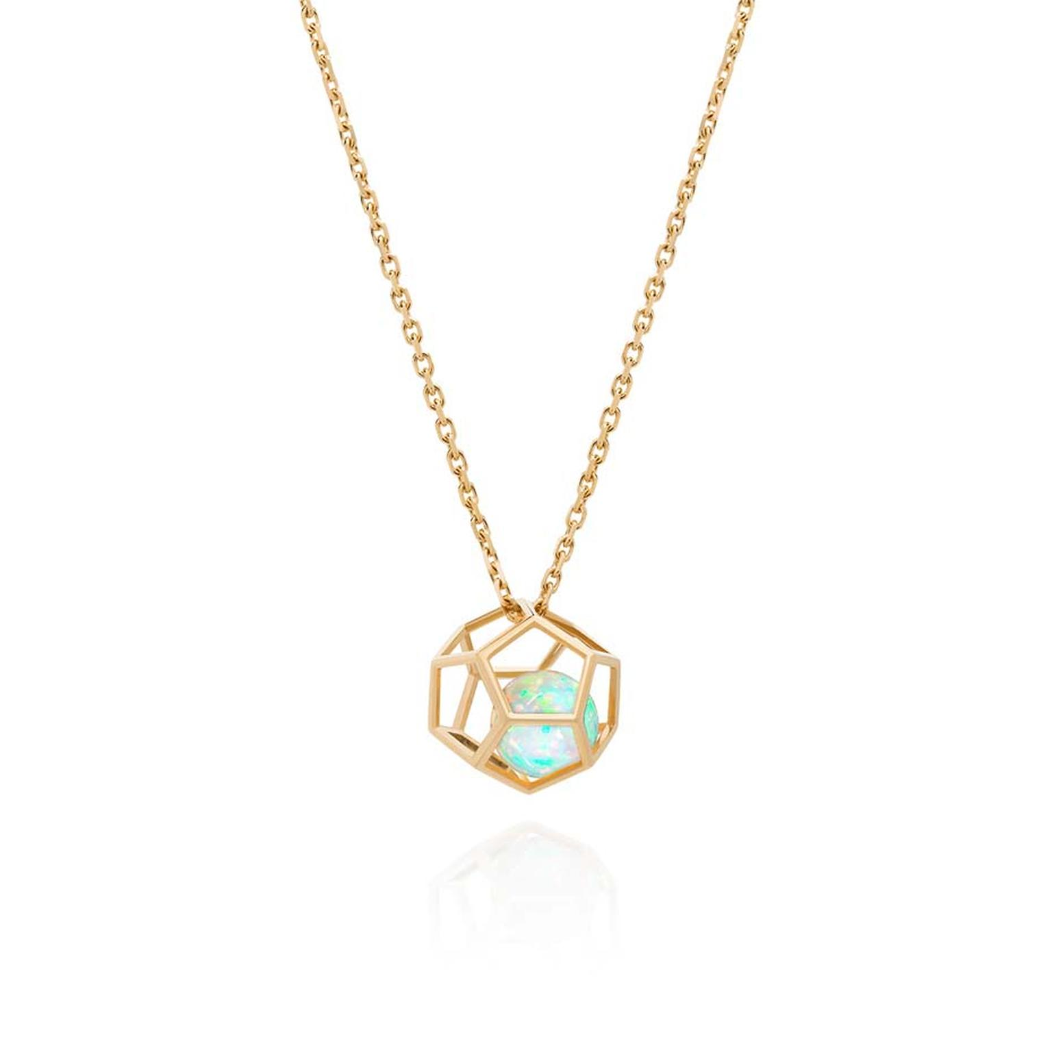 Ornella Iannuzi Rock It! necklace featuring an opal floating inside a gold dodecahedron cage.