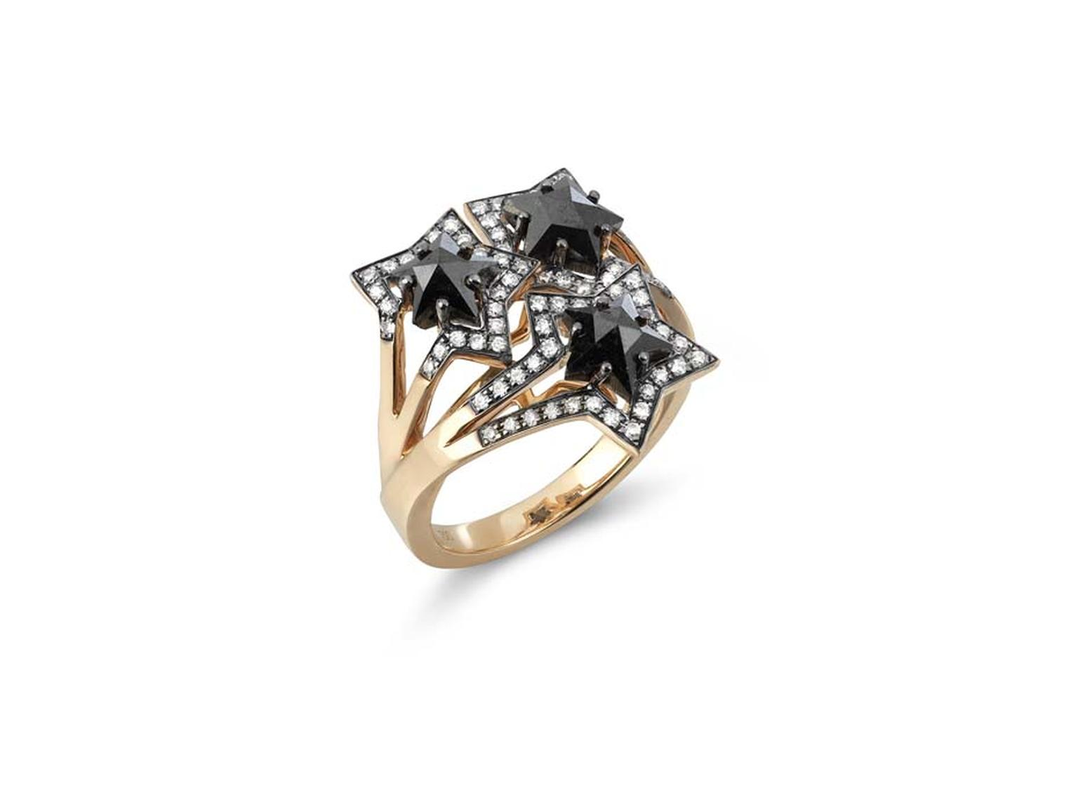 Tomasz Donocik Three Star ring with black diamond stars outlined in white diamonds.