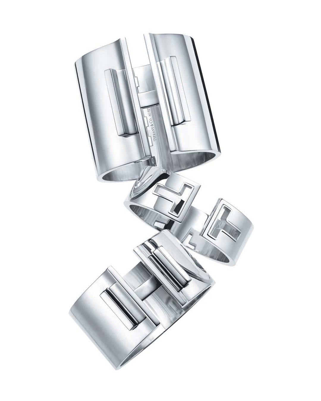 Tiffany and Co. Tiffany T bar hinged cuffs in sterling silver.