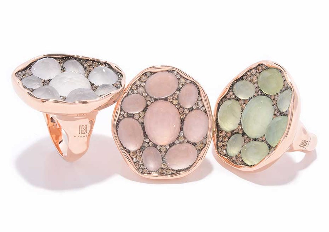 Rodney Rayner red gold rings featuring, from left to right, white quartz, rose quartz and prehnites surrounded by a sprinkling of diamonds.