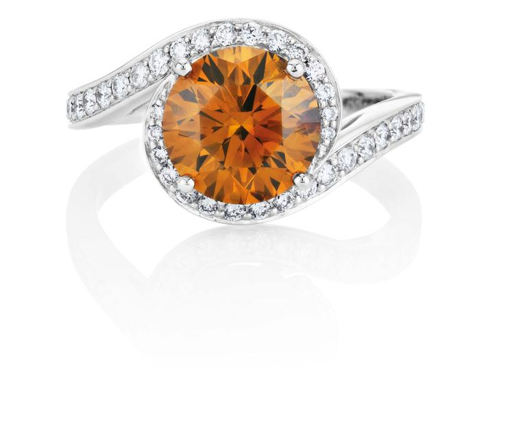 De Beers 1888 Master Diamonds Caress ring, set with a 2.53ct round brilliant Fancy deep brown-orange diamond.