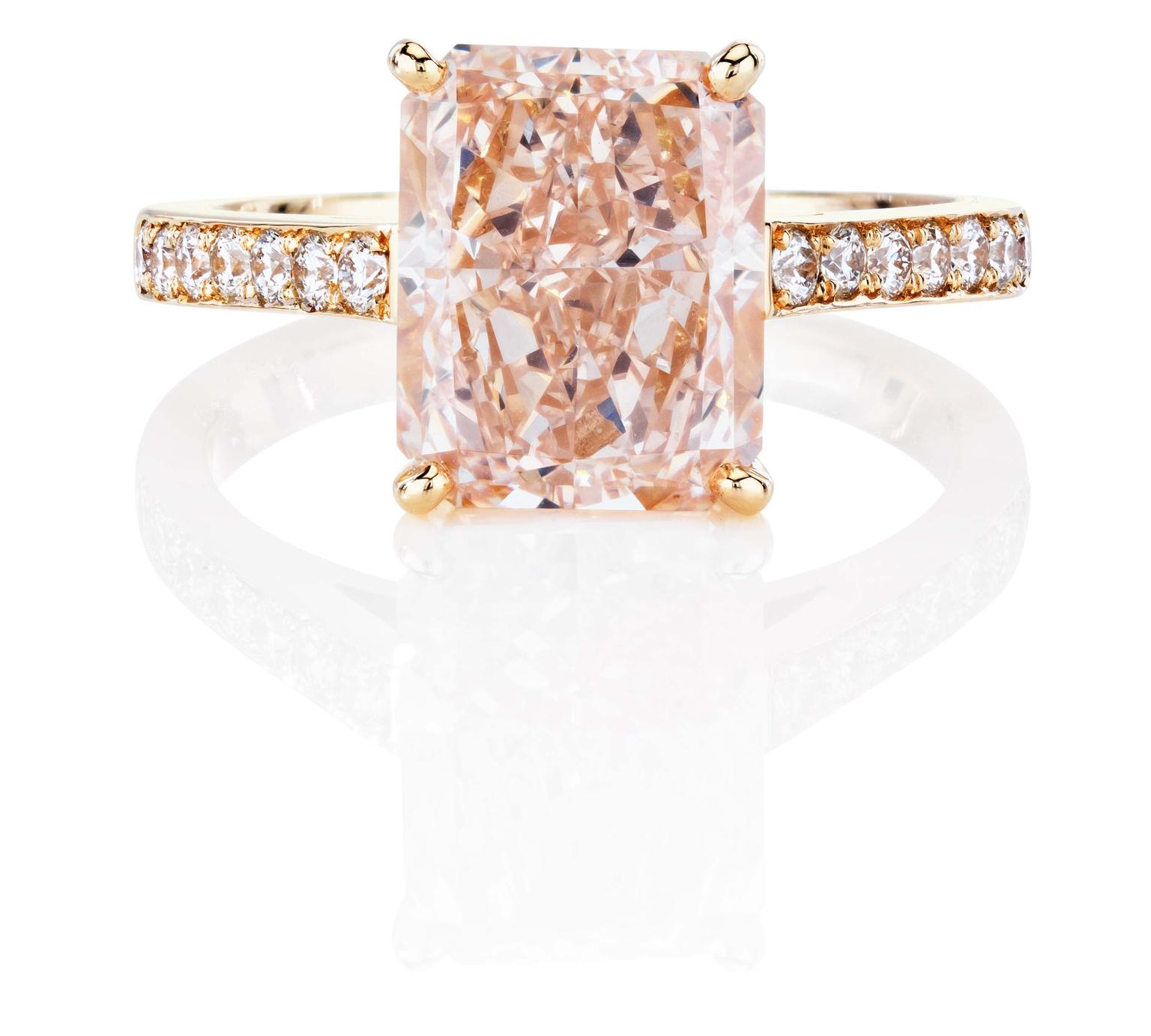 De Beers 1888 Master Diamonds DB Classic ring, set with a Radiant fancy pink diamond with a pavé diamond set band.