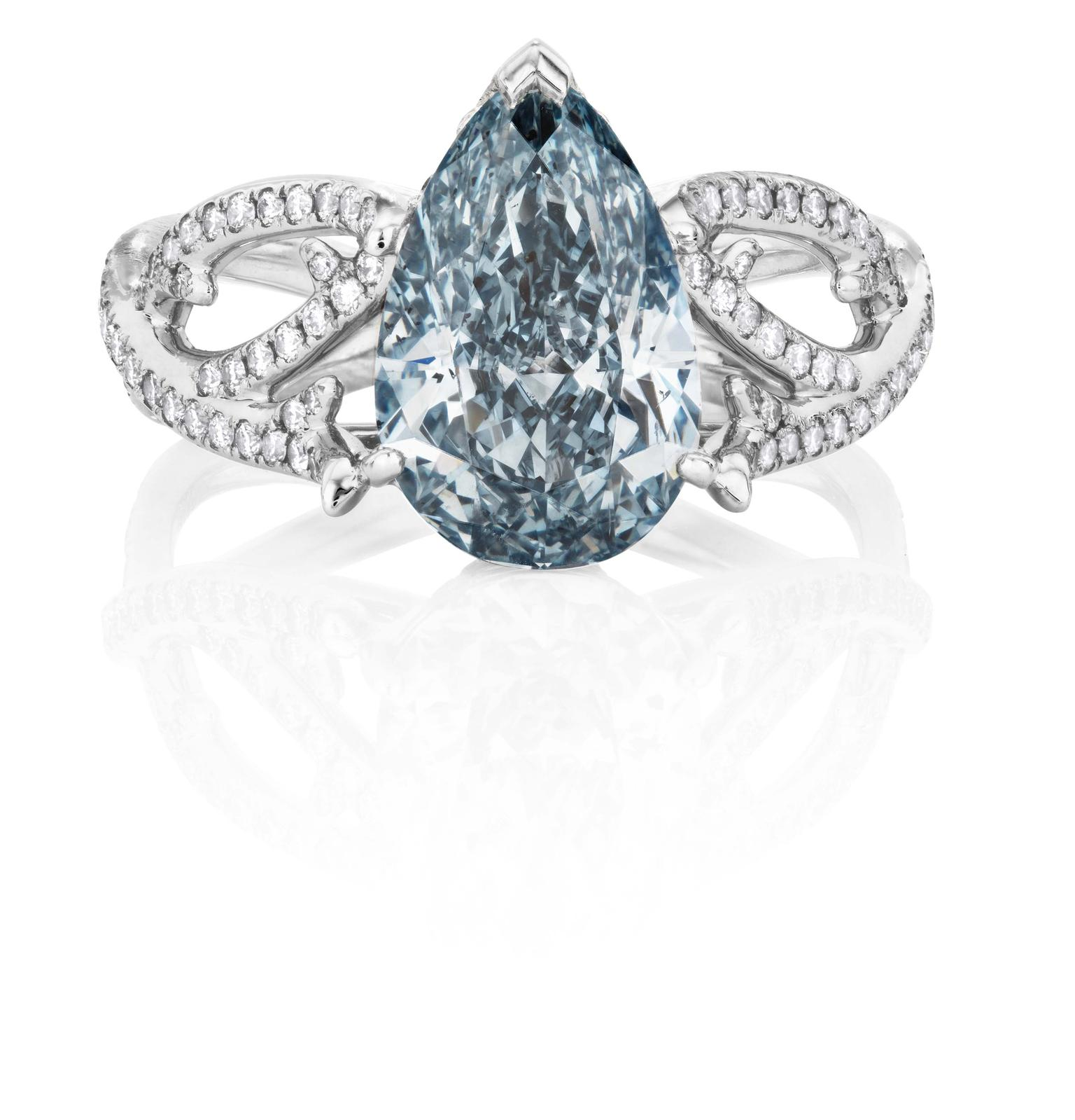 De Beers 1888 Master Diamonds Volute ring featuring a pear-shaped blue diamond solitaire.