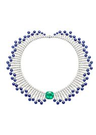 Extremely Piaget collection necklace in white gold set with 127.40ct blue sapphire beads, 41.69ct brilliant-cut diamonds and a 19.39ct cushion-cut emerald.
