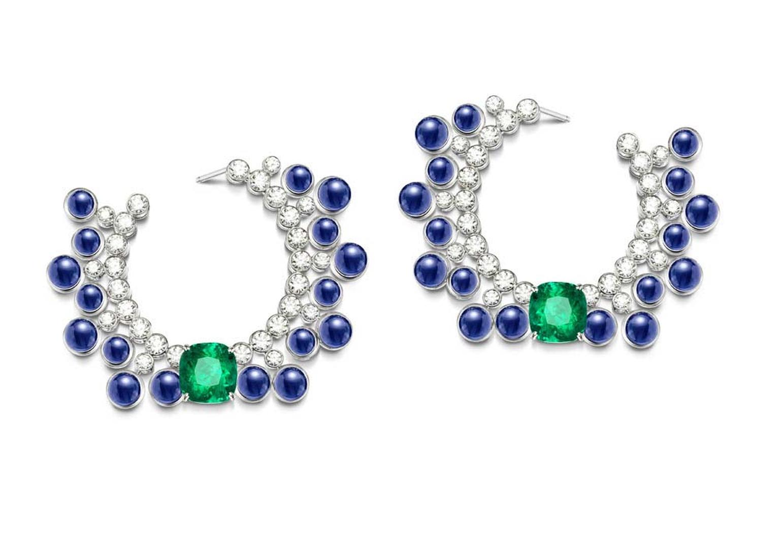 Extremely Piaget collection earrings in white gold set with 34 cabochon-cut blue sapphires, two cushion-cut emeralds and brilliant-cut diamonds.