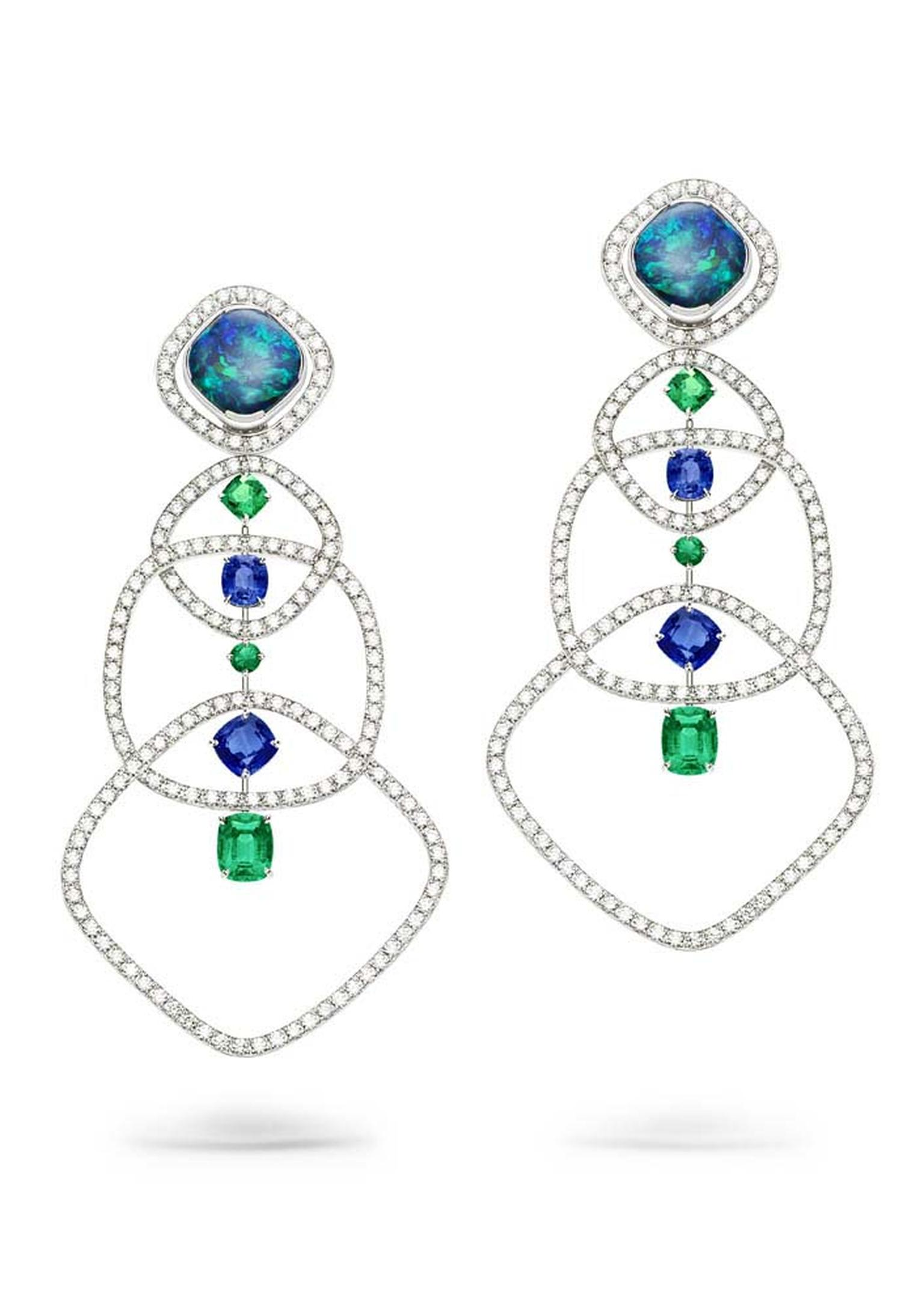 Mix and match your earrings with the opal-dial cuff watch in these Extremely Piaget earrings in white gold set with two cushion-cut black opals, brilliant-cut diamonds, blue sapphires and emeralds.