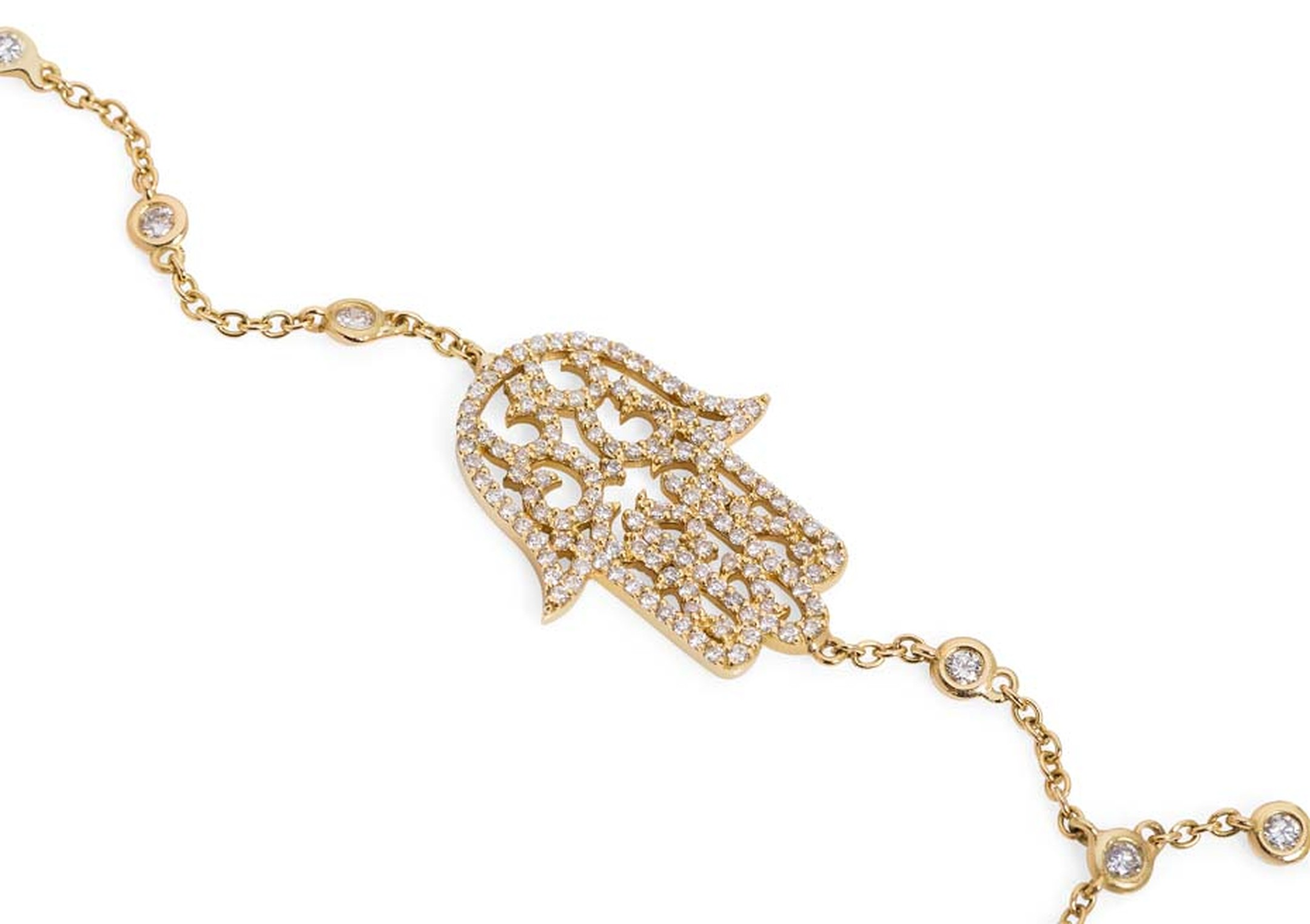Noudar Jewels' Hamsa finger bracelet draws on elements from both Arabic and Islamic cultures.