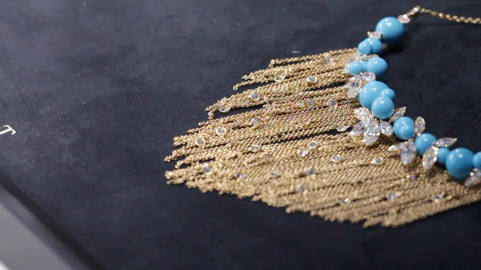 Extremely Piaget necklace with interspersed brilliant-cut diamonds amongst gold tassels hanging from turquoise beads and pear-shaped diamonds.