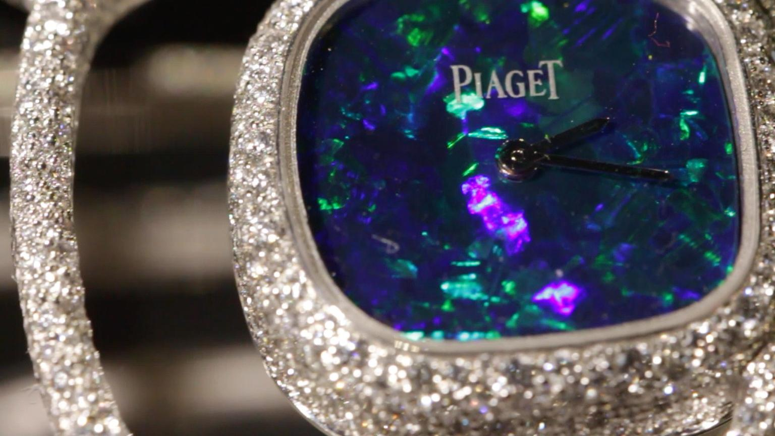 The Extremely Piaget collection Reversible cuff watch in white gold is set with 11.7ct of 2,008 brilliant-cut diamonds in a snow-setting. It also features a natural opal dial on the front and natural onyx dial on the back.