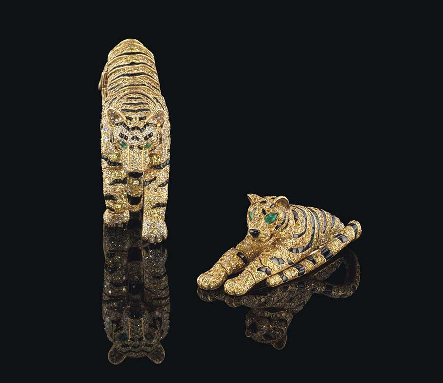The Cartier Tiger bracelet and clip brooch, with diamonds, onyx and emeralds, which once belonged to the Duchess of Windsor and Sarah Brightman, are being sold as one lot at Christie's Magnificent Jewels auction on 11 November 2014 with a combined pre-sal