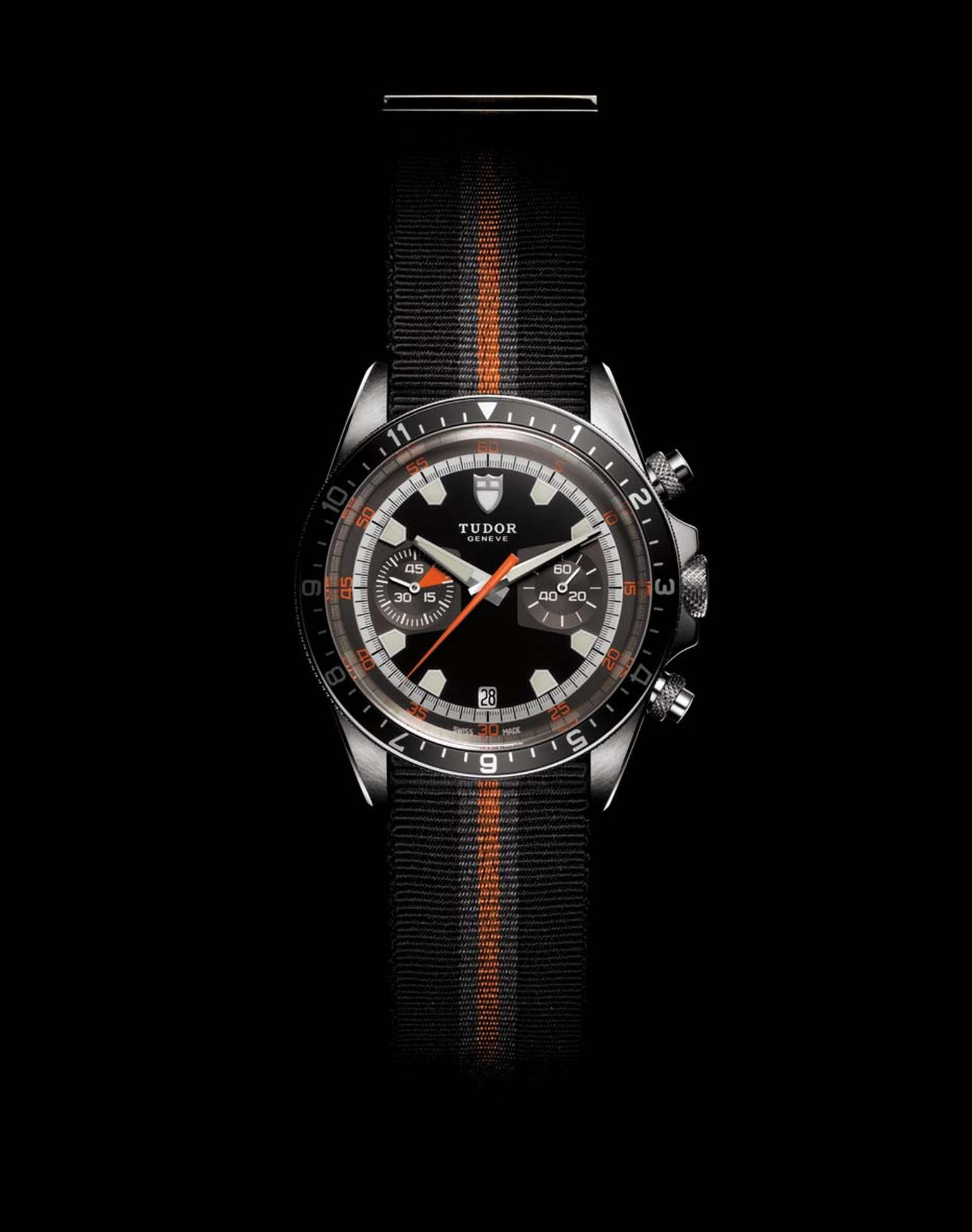 Reflecting the design of the original 1970s Chrono, the retro Tudor Heritage Chrono watch features a mechanical alarm as well as a black, grey and orange fabric strap, with a seat belt-inspired buckle.