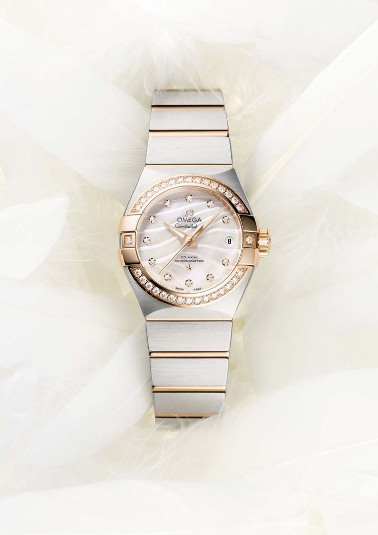 The 27mm Omega Constellation Pluma watch features a mother-of-pearl dial and diamond indices.