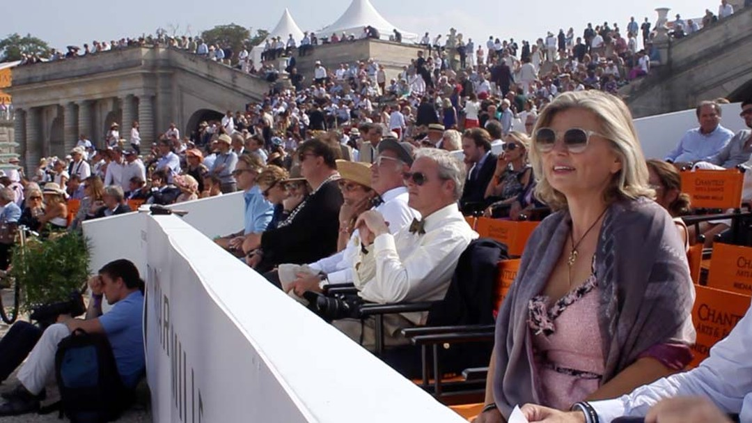 Maria Doulton sits in the stands as she enjoys automobile history unfold before her at Chantilly Arts & Elegance.