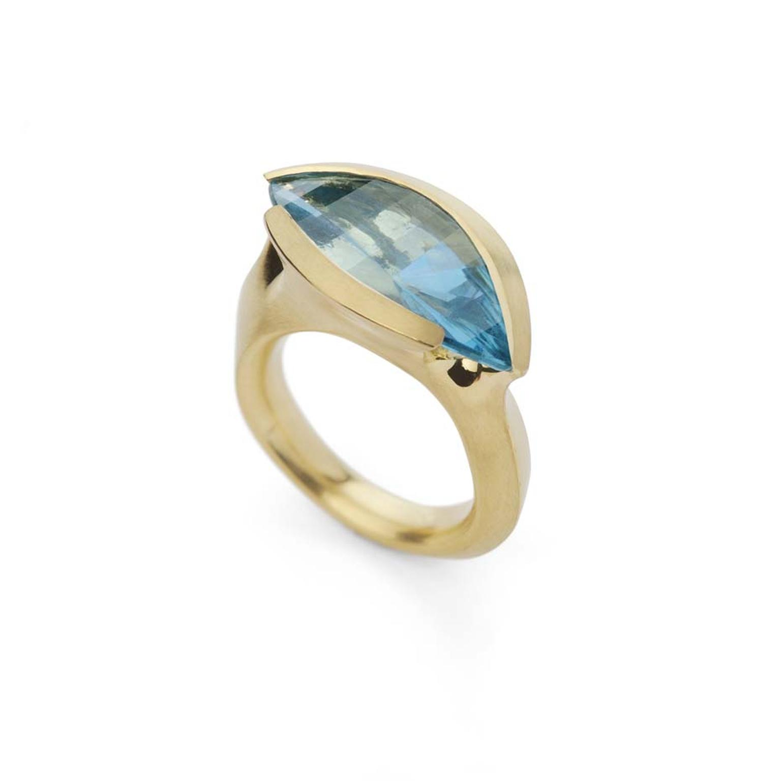 McCaul Goldsmiths Carve collection ring with a marquise-cut aquamarine set in gold.