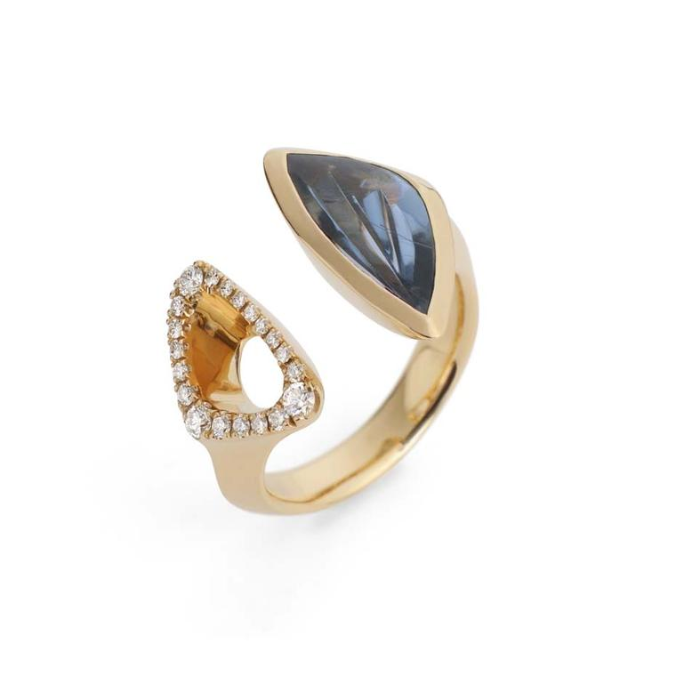 McCaul Goldsmiths Carve ring with an indicolite juxtaposed by a gold diamond-set frame.