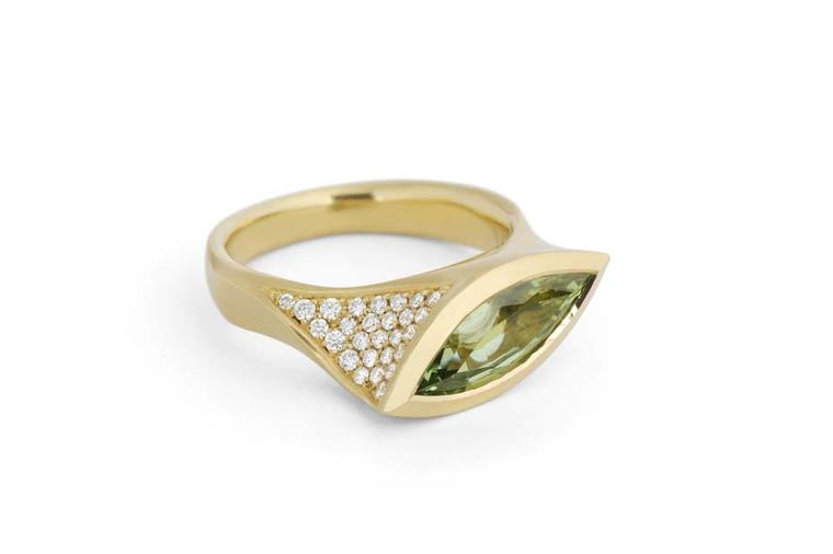 McCaul Goldsmiths Carve collection ring with a mint green garnet surrounded by diamonds.