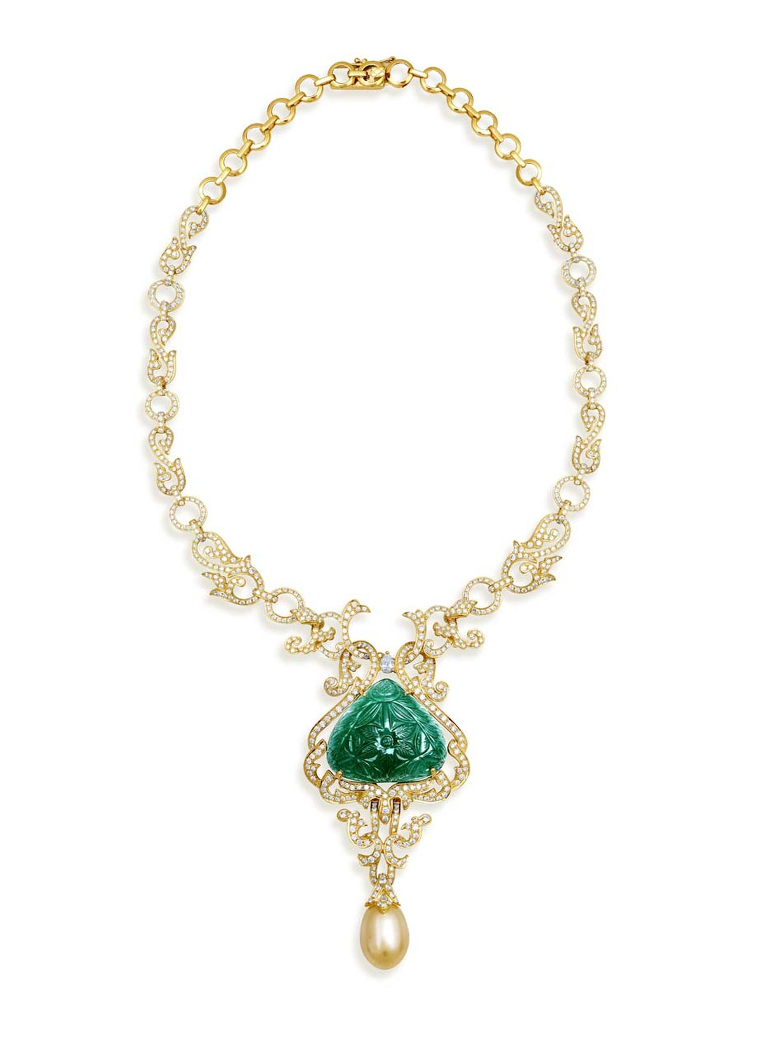 Farah Khan gold necklace with a large central carved emerald, South Sea pearl drops and diamonds, inspired by the grandeur of the Indian Maharanis.