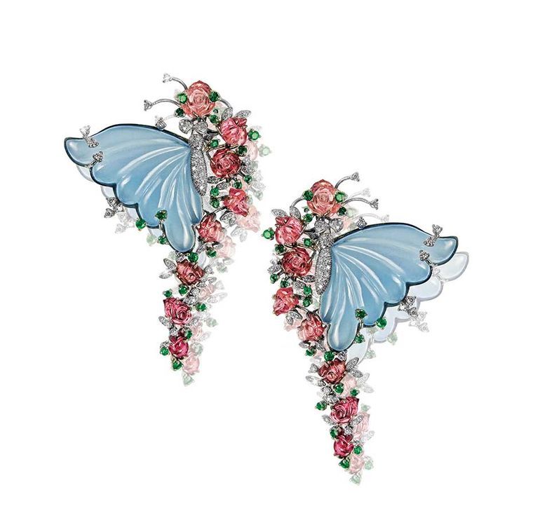 Butterfly earrings by Mirari with carved blue onyx wings, tourmaline flowers, emeralds and diamonds.