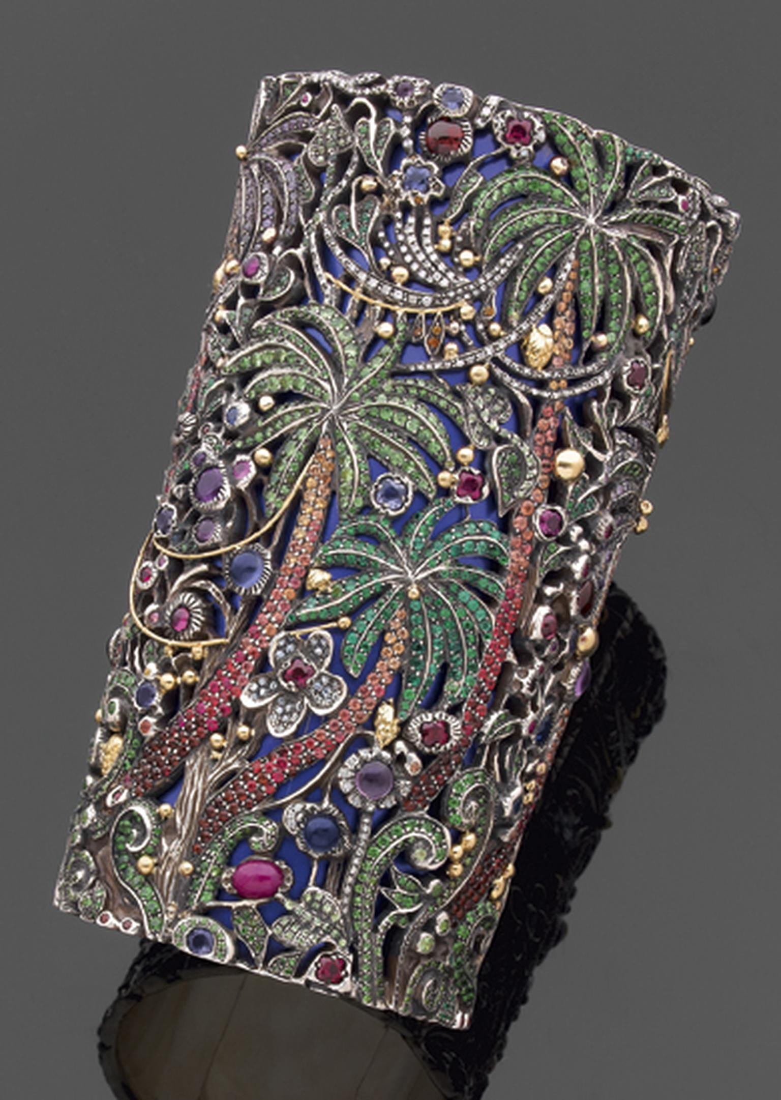 Jean Boggio Jungle cuff in gold and silver with amethyst, aquamarine, emerald, garnet, tsavorite and blue topaz.