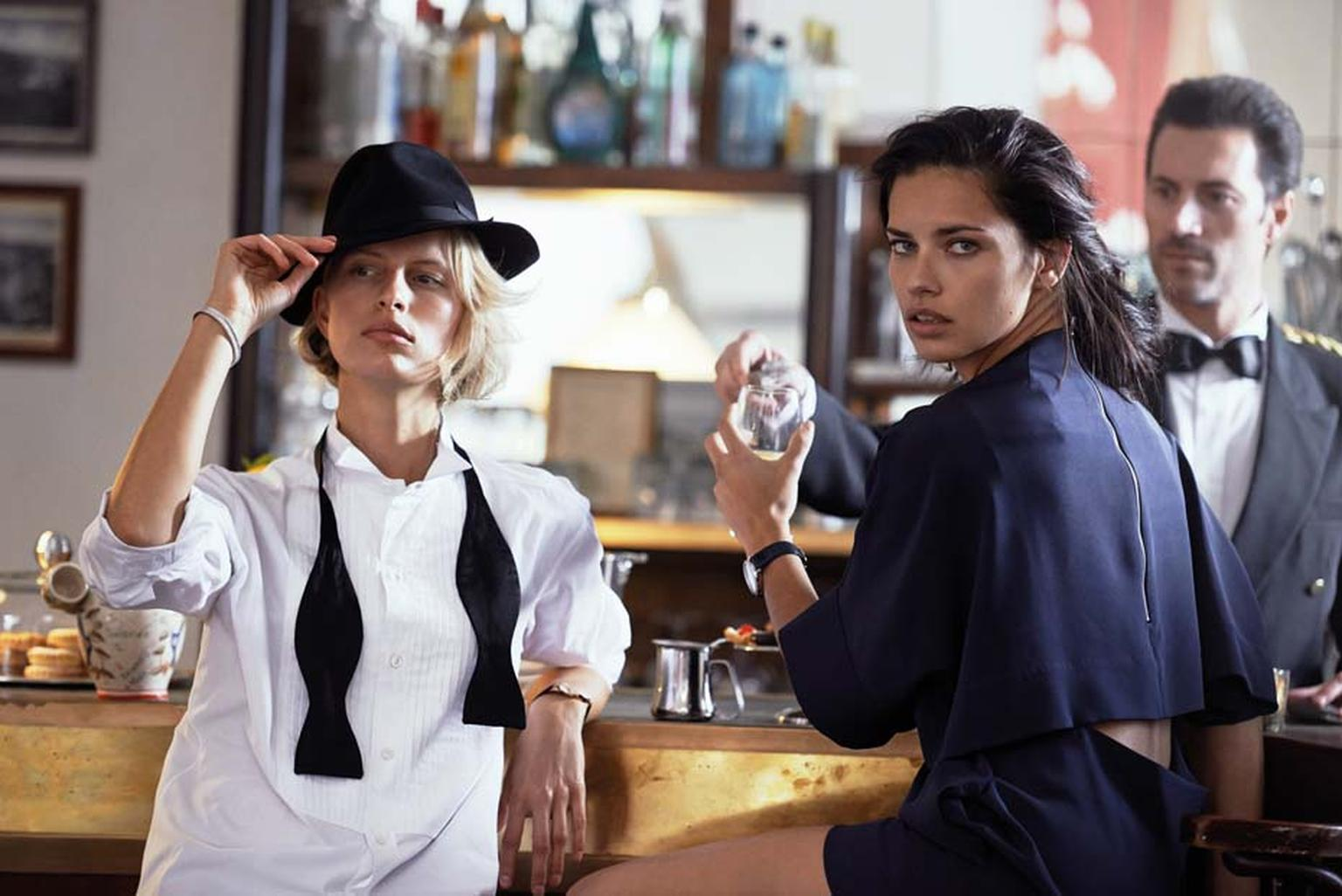 Casually sporting IWC's latest Portofino watches, Karolina Kurkova and Adriana Lima bring even more beauty to the Mediterranean town of Portofino.
