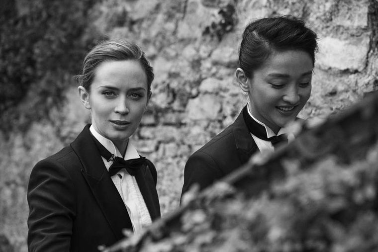 Renowned photographer Peter Lindbergh captures a candid moment with Emily Blunt and Zhou Xun.