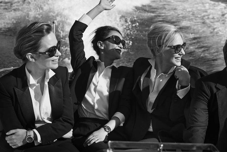 "IWC's ""Timeless Portofino"" photo shoot features actresses Cate Blanchett, Emily Blunt and Zhou Xun, exuding grace and sophistication with chignons and black tuxedo blazers on board a Riva speedboat."