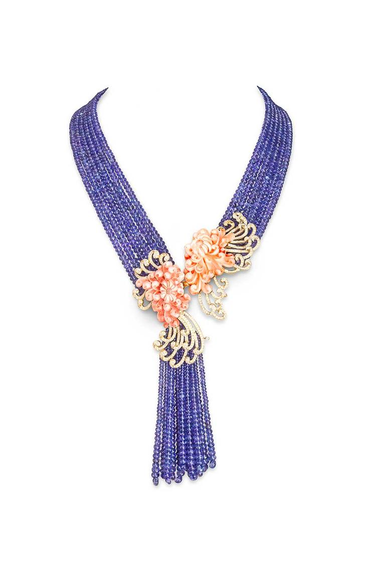 Farah Khan's asymmetric coral necklace strung on tanzanite beads.