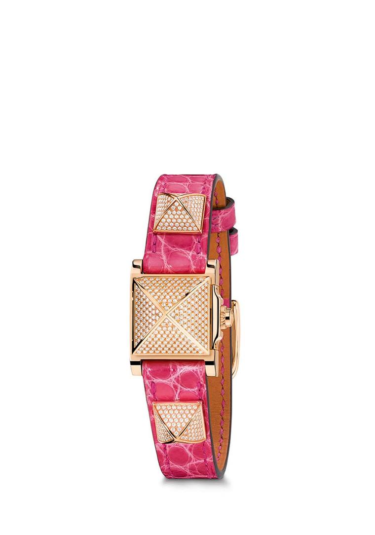 Hermès Médor watch with a pink leather bracelet with three pronounced rose gold pyramid studs set with pavé diamonds.