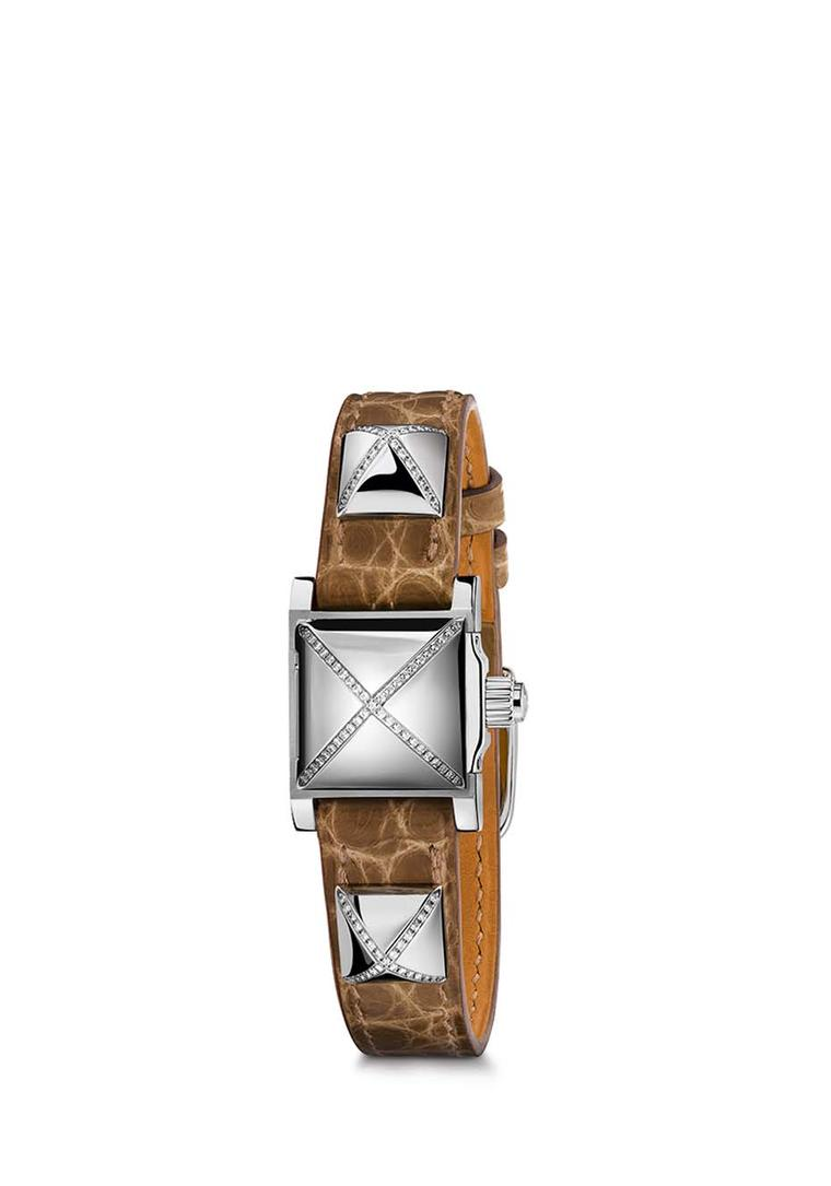 Hermès Médor watch with three pyramids featuring a cross of pavé diamonds on an alligator strap.