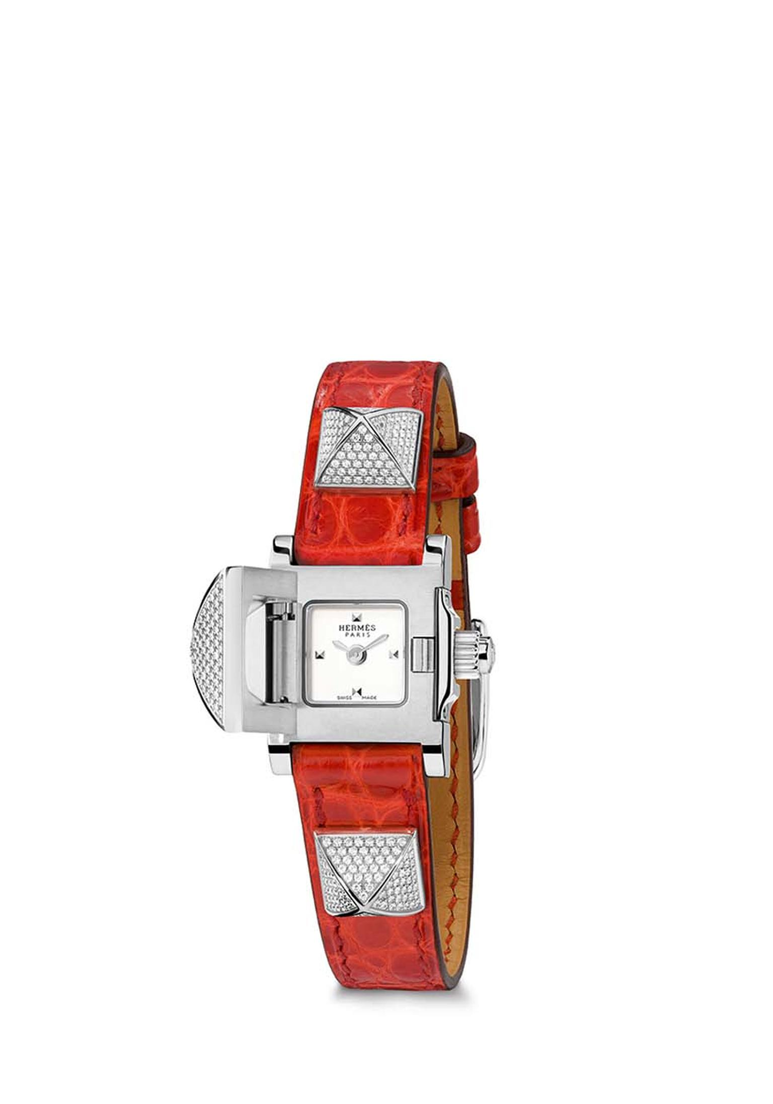 Hermès Médor watch with a smooth red agate alligator strap and three full diamond-set pyramids.