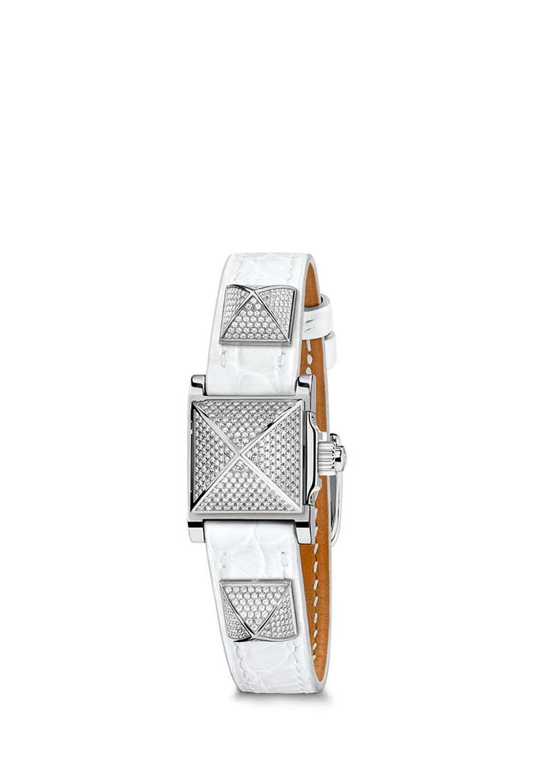 Hermès Médor watch with a cloud white alligator strap and three diamond pavé set pyramids.