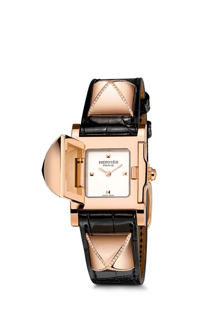 Hermès Médor watch with three partially set diamond pavé pyramids above a smooth ember alligator strap.