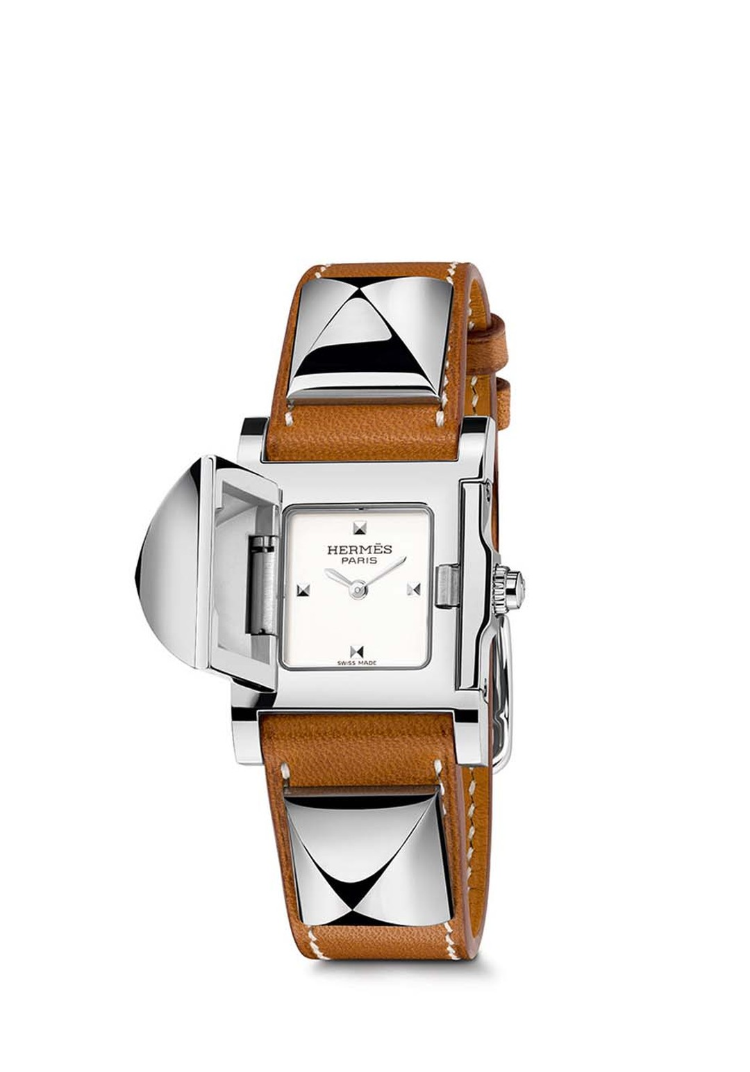 "Pictured with a natural Barenia calfskin strap, the Hermès Médor watch was launched in 1993 when the leather strap with its ""Clous de Paris"" pyramid-shaped studs caught the eye of a designer at Hermès and was transformed into a secret watch."