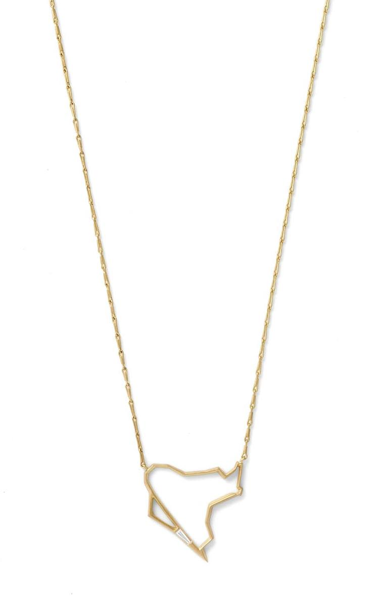 Monique Péan Seto geometric pendant in gold, set with a delicate white diamond baguette.