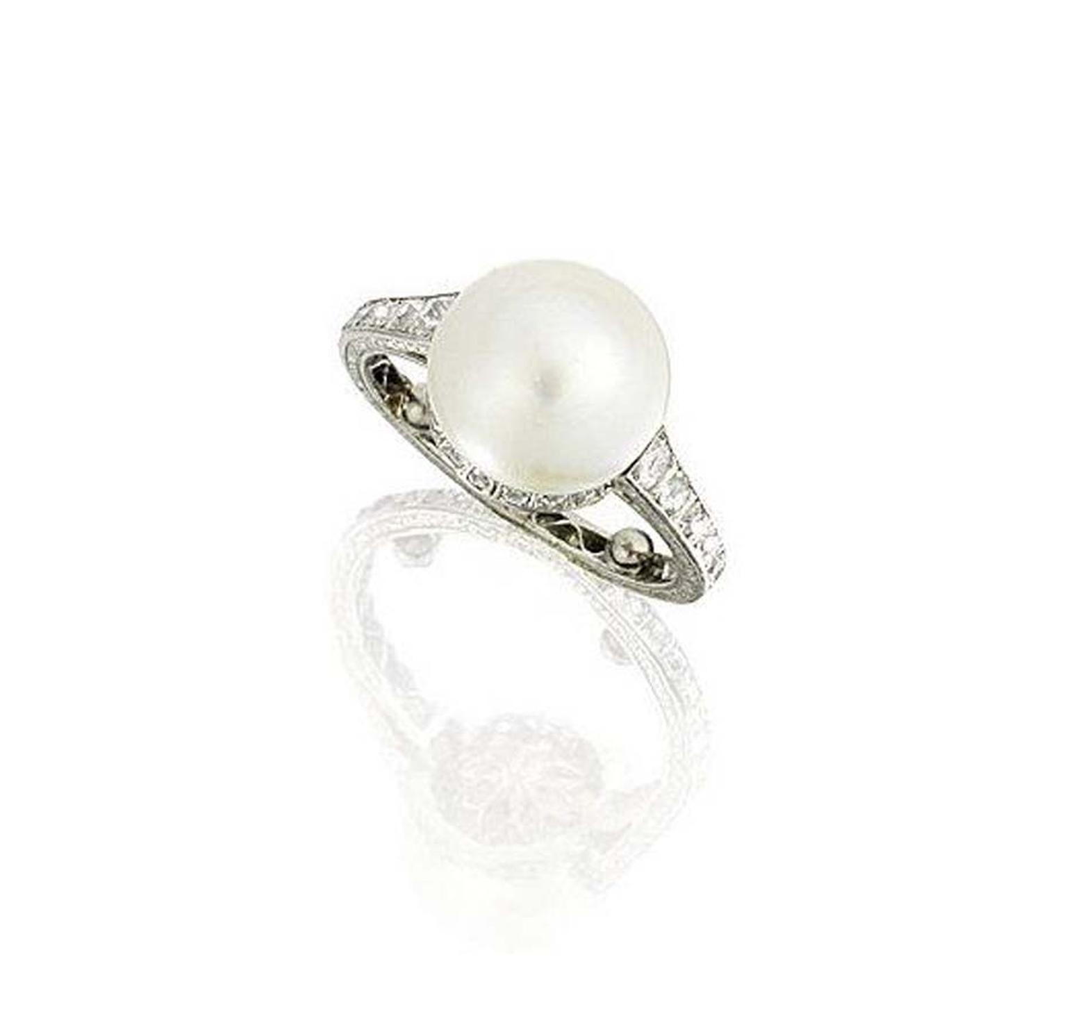 A 1930s diamond and natural pearl ring on an engraved band which sold for £47,500 at Bonhams Fine Jewellery sale.