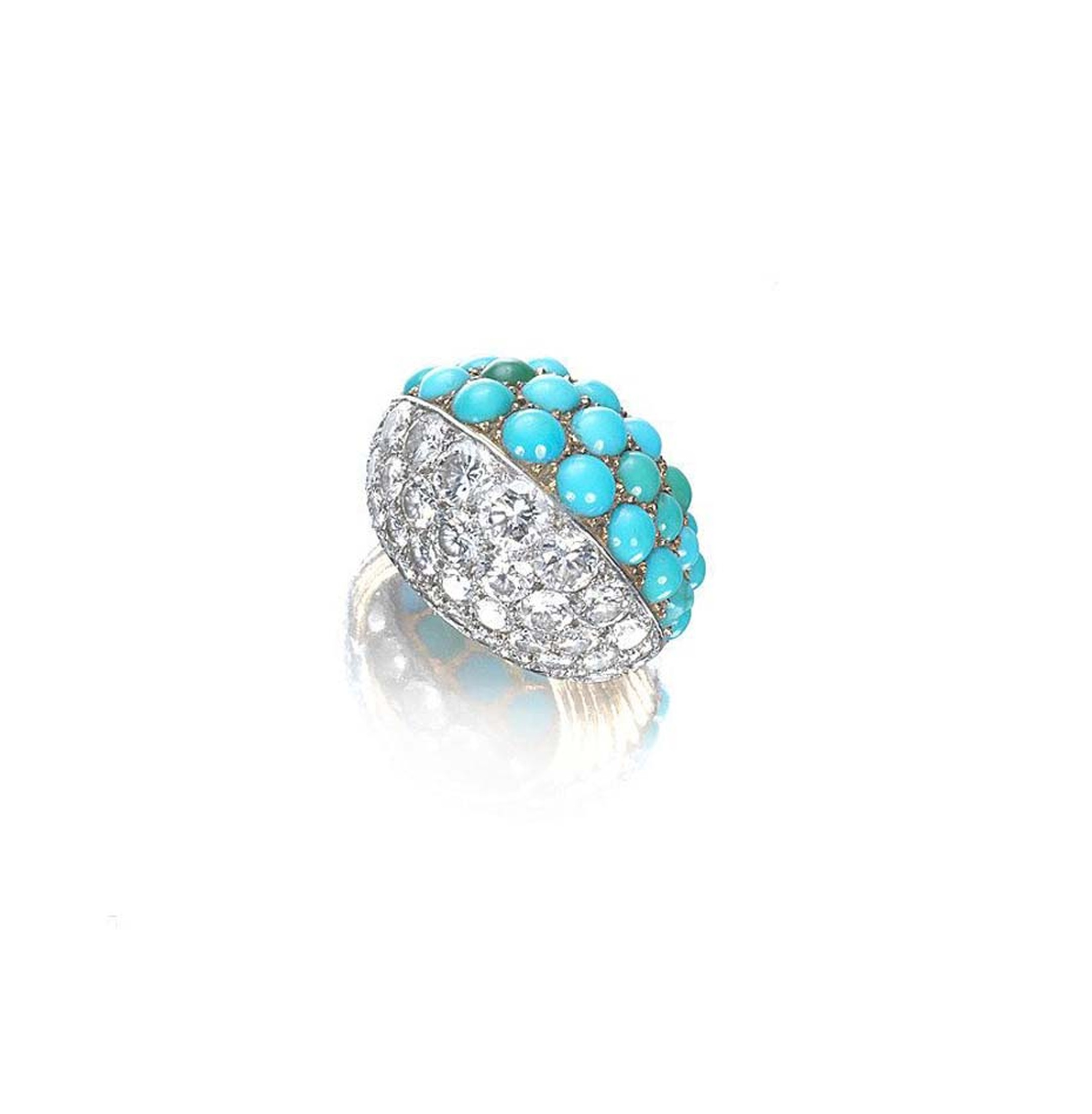 A turquoise and diamond Cartier cocktail ring circa 1960.The bombé design features pavé-set diamonds on one side and cabochon turquoise beads and brilliant-cut diamonds on the other.  The ring sold for £17,500, nearly quadruple its pre-sale estimates.