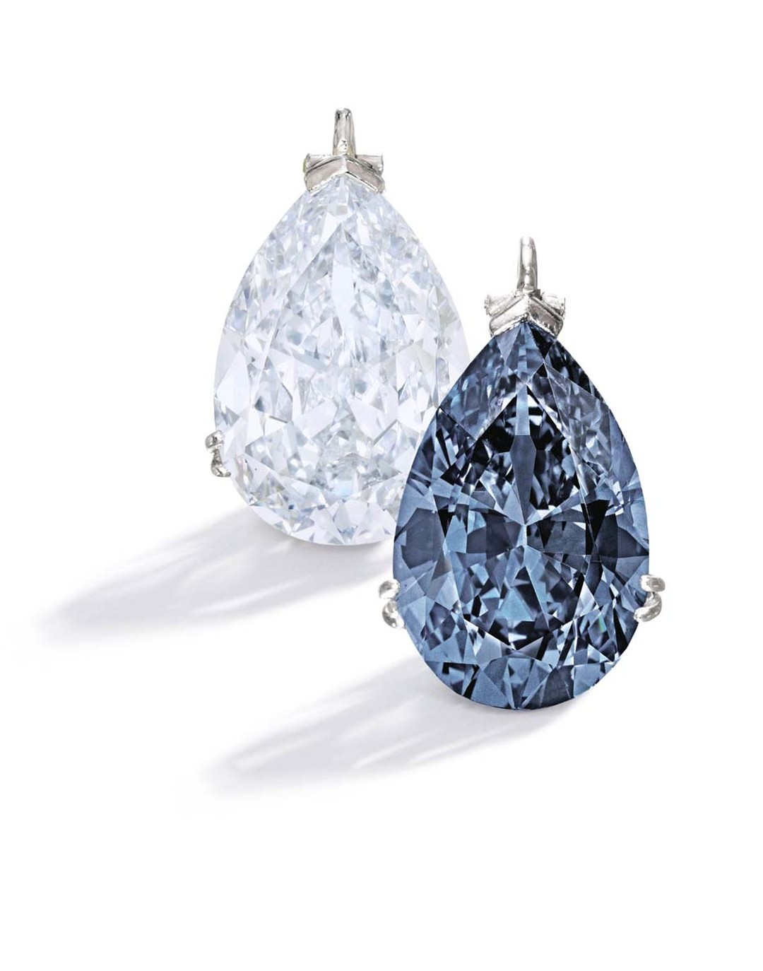 Bunny Mellon's jewelry collection, which will be auctioned by Sotheby's New York on 20 November 2014, includes two platinum mounted blue diamond pendants. One is an important 9.15ct Fancy Blue diamond, left, and the other a magnificent and rare 9.74ct Fan