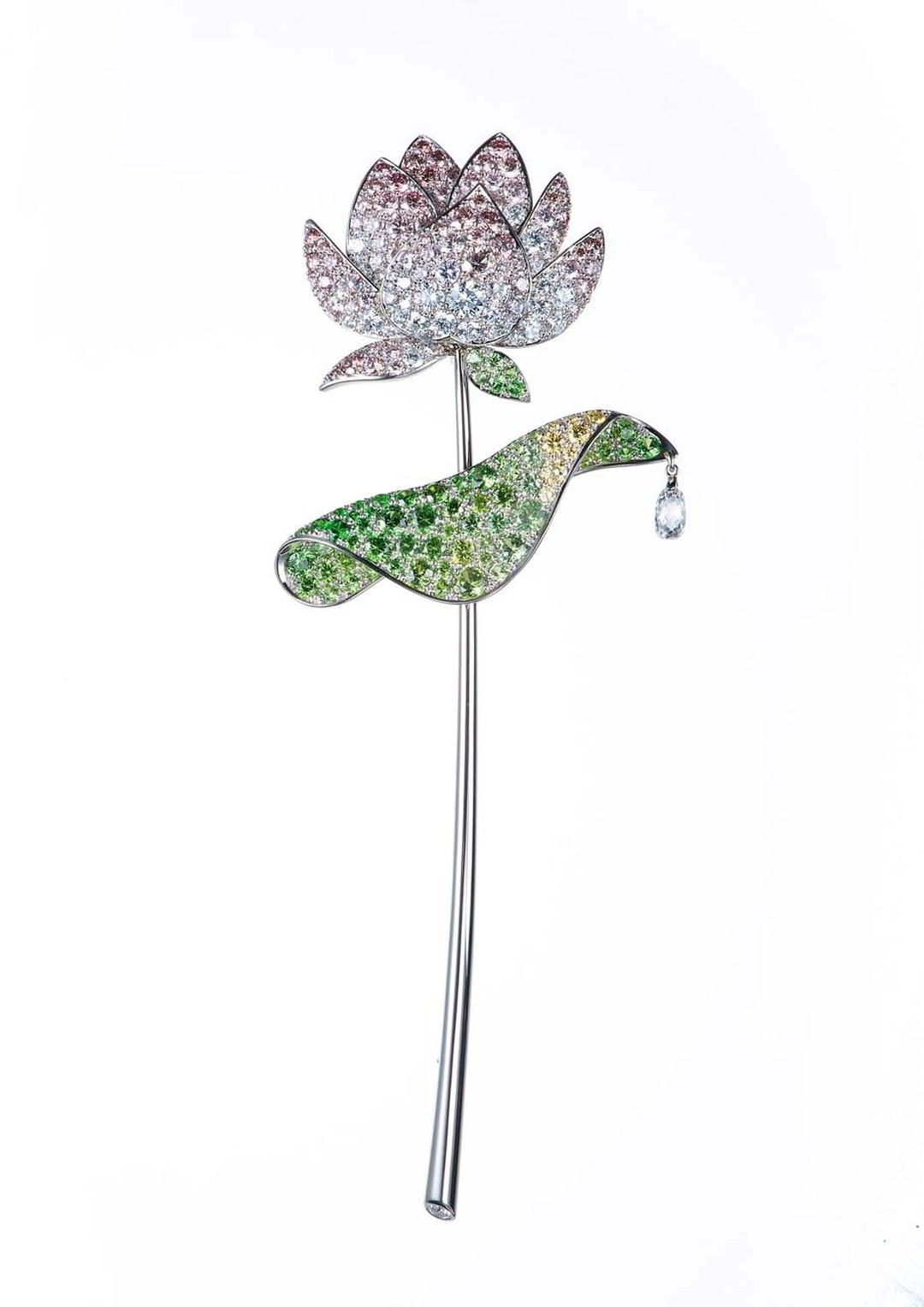 Gimel's platinum Lotus brooch from 2001 featuring a flower head with pavé-set pink and colourless diamond petals leading to a circular-cut demantoid garnet and yellow diamond leaves. © Gimel Trading Co., Ltd.