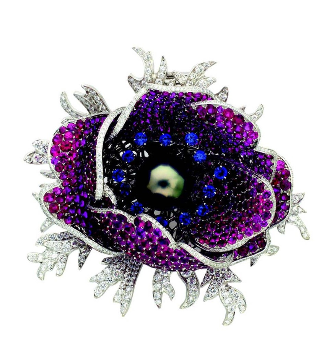 Van Cleef & Arpels 2008 Garance Poppy clip set with rubies, blue sapphires and a grey cultured pearl © Van Cleef & Arpels.