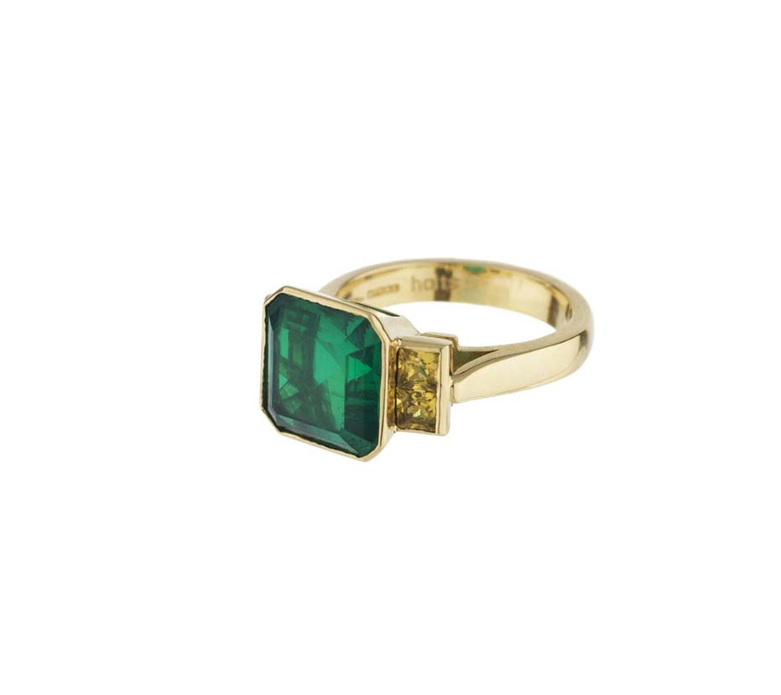 Holts London collection yellow gold Strand ring featuring a doublet centre emerald with yellow sapphire set shoulders.