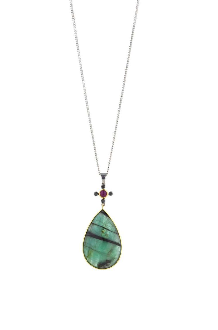 Holts London Portobello pendant with a rose-cut emerald drop with black inclusions suspended from a cross set with a ruby cabochon and black diamonds (£1,845).