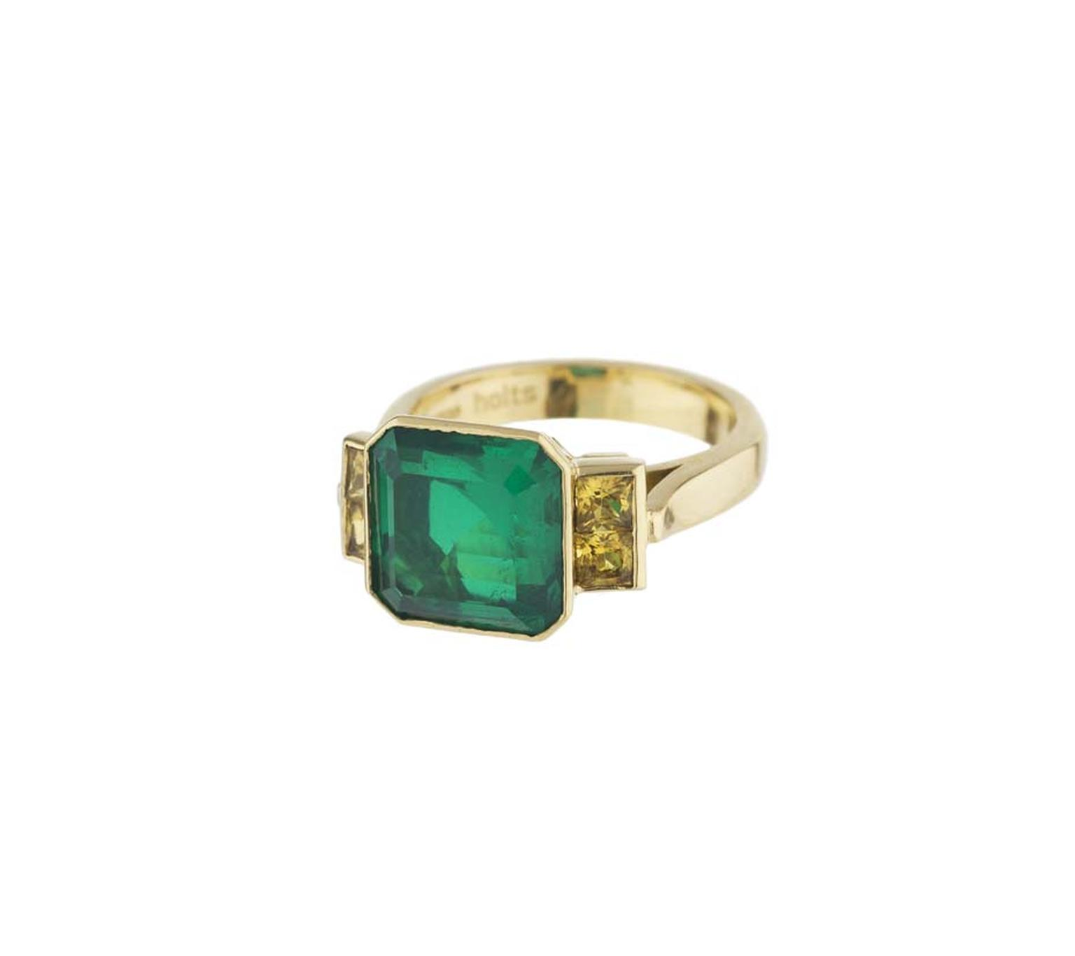 Holts London Strand ring in yellow gold featuring an emerald doublet with yellow sapphire-set shoulders (£2,850).