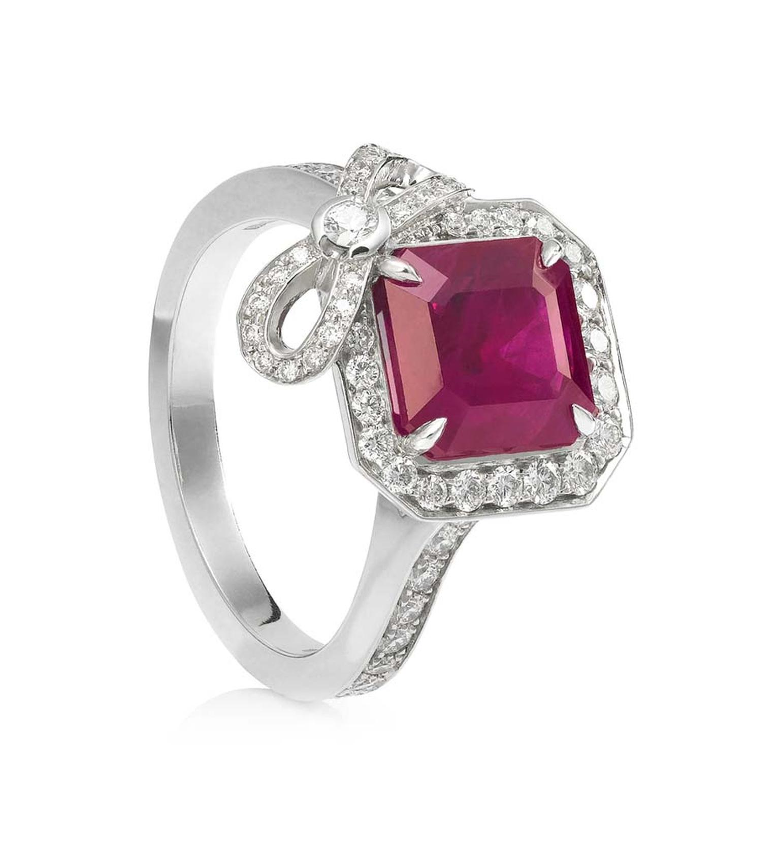 Boodles Vintage Rosette cushion-cut ruby engagement ring in platinum surrounded by melée diamonds and a pretty diamond bow.