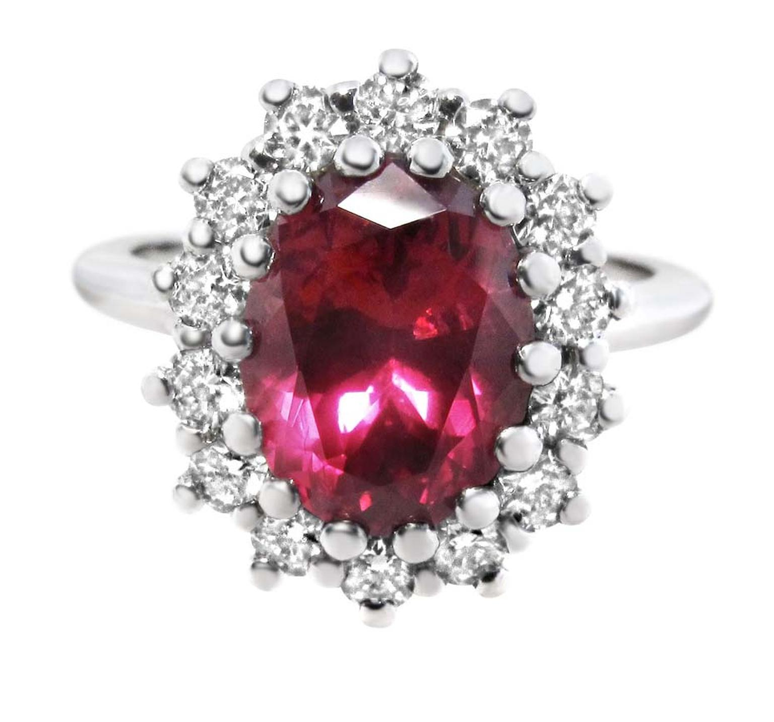 Ingle & Rhode Cluster ruby engagement ring featuring an untreated oval-shaped Malawi ruby surrounded by brilliant-cut diamonds.
