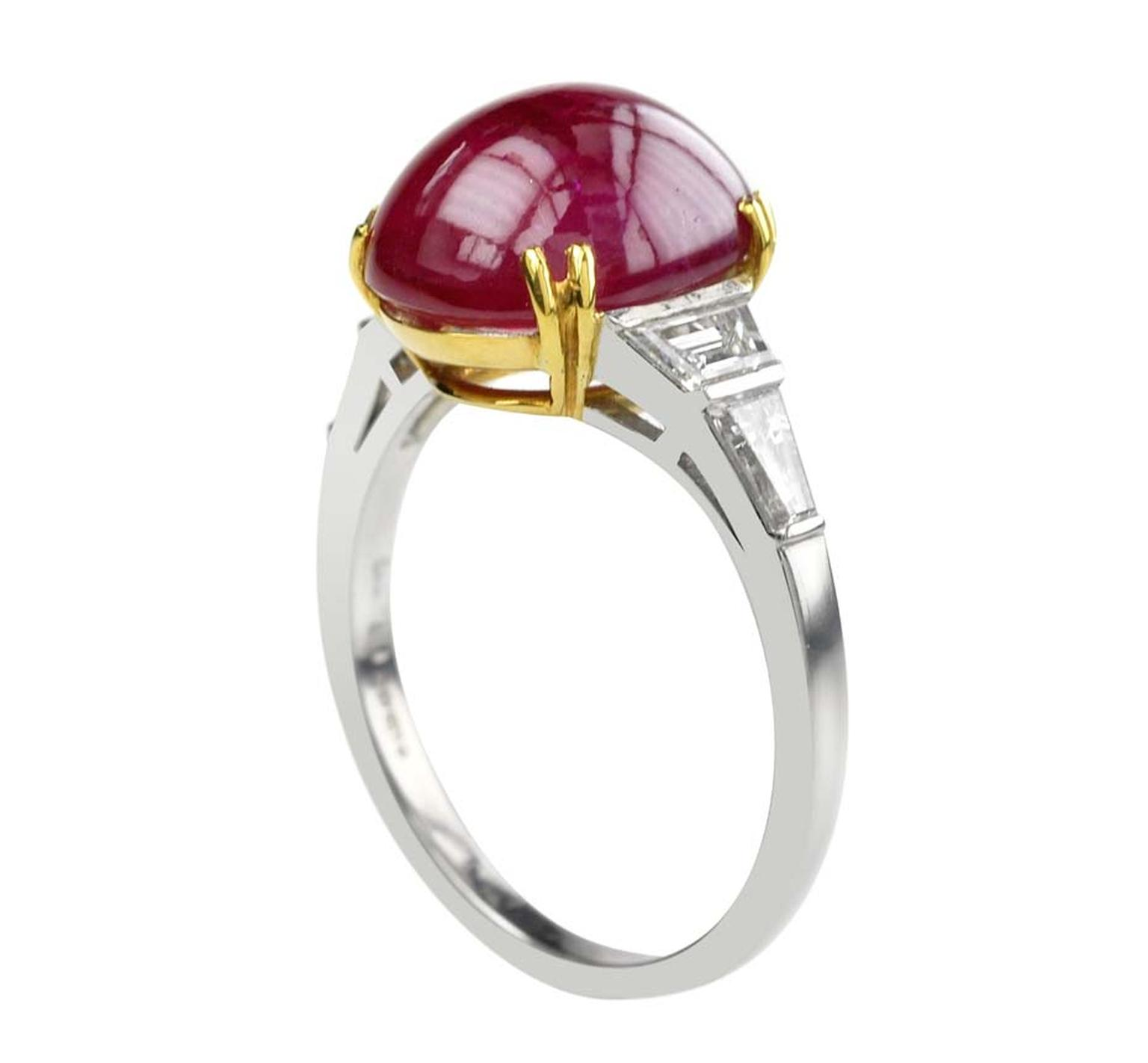 Lucie Campbell ruby engagement ring with a cabochon ruby set in yellow gold and a diamond band set in platinum and white gold.