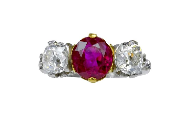 Lucie Campbell Burmese ruby engagement ring in platinum flanked by brilliant-cut diamonds.
